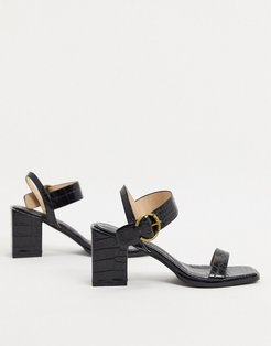 Oni block heeled sandals in black croc
