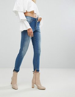 Skinny Jean with Stepped Hem and Shadow Pocket Detail - Blue