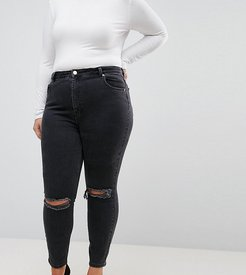 ASOS DESIGN Curve super high rise firm skinny jeans with busted knees in washed black - Black