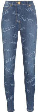 all-over logo print skinny jeans - Blue