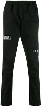 relaxed-fit graphic print trousers - Black