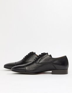 Legawia toe cap lace up shoes in black leather