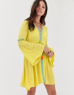 Midi Length Yellow Plunge Neck Beach Dress With Embroidered Panels and Tassel Tie