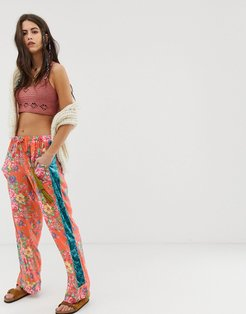 relaxed pants with contrast velvet side stripe in floral-Red