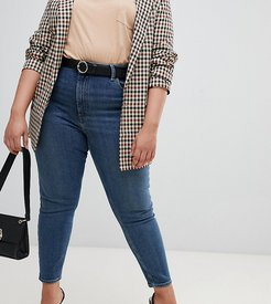 ASOS DESIGN Curve Recycled super high rise firm skinny in aged mid stonewash blue