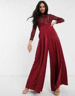 long sleeved wide leg jumpsuit with embellished top in deep red