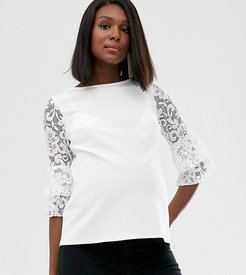 exclusive lace sleeve top in white