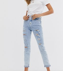 ripped skinny jeans in light blue