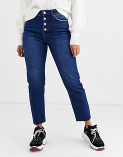 straight leg jean with exposed buttons in dark blue
