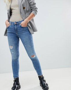 amelie distressed skinny jeans in mid wash-Blue
