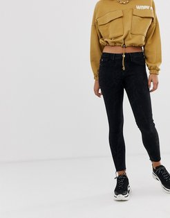 Molly skinny jeans with raw hem in washed black