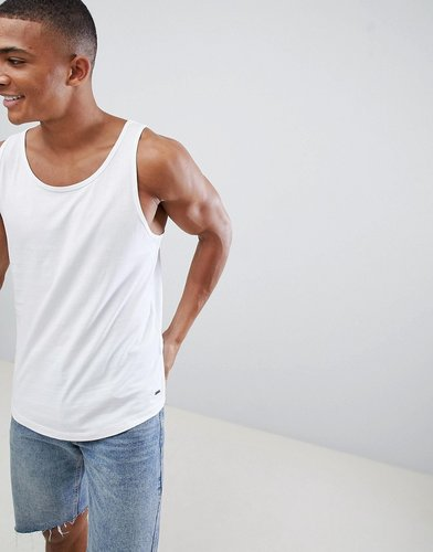 Longline Tank With Raw Curved Hem In White - White
